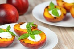 Grilled peaches and mascarpone with mint Royalty Free Stock Photos
