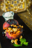 Grilled peaches with nuts and ice-cream Stock Images