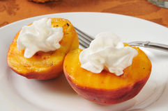 Grilled peaches with whipped cream Royalty Free Stock Photo
