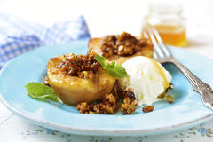 Grilled pear with caramelized walnuts and honey. Stock Image