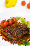 A grilled peppercorn - steak with tomato lettuce Stock Photos