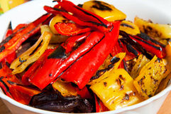 Grilled Peppers. Grilled red, yellow and orange sweet peppers in a bowl stock image