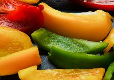 Grilled peppers on a hot grill. Different colors - red, green, yellow Stock Photo