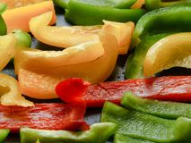 Grilled peppers on a hot grill. Different colors - red, green, yellow Royalty Free Stock Photography