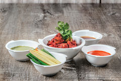 Grilled pieces of chicken in curry in a bowl. The meat is served Royalty Free Stock Images