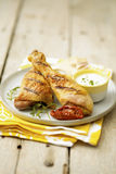 Grilled pieces of chicken with parmesan sauce Royalty Free Stock Images