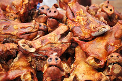 Grilled pig heads at ecuadorian farm market Stock Photo