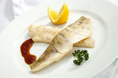 Grilled Pikeperch with lemon Royalty Free Stock Images