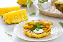 Grilled Pineapple. With fresh mint on top Royalty Free Stock Photo