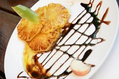 Grilled pineapple with chocolate. Delicious grilled pineapple with chocolate and caramel Stock Photography