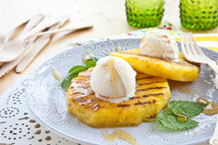 Grilled pineapple with ice cream Royalty Free Stock Photography