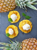 Grilled pineapple with ice cream Stock Images