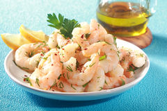 Grilled pink shrimps seasoned with fresh herbs Royalty Free Stock Image