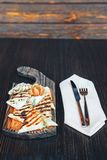 Grilled pita bread with cheese on a wooden board royalty free stock image