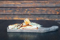 Grilled pita bread with cheese on a wooden board royalty free stock photos