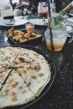 Grilled pladina with Spinach and Cheese and Lemon soda, Calamari stock photos