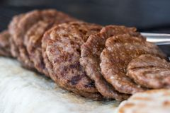 Grilled pljeskavica stacked on a fair stall Royalty Free Stock Photos