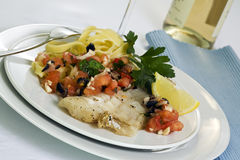 Grilled pollock with tagliatelle and hot salsa Royalty Free Stock Image