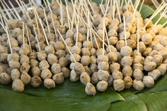 Grilled pork balls on bamboo basket weave.Grilled pork balls on banana leaves Royalty Free Stock Photo