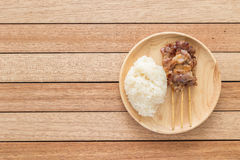 Grilled pork with bamboo stick and Thai sticky rice on wooden di Royalty Free Stock Photography