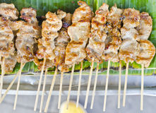 Grilled pork on the banana leaf. Royalty Free Stock Photo