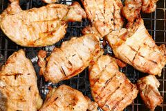 Grilled pork, Barbecue, Grilled BBQ meat food on fireplace grill, Meat meal background cut into grilled pieces top view. The Grilled pork, Barbecue, Grilled BBQ stock photos