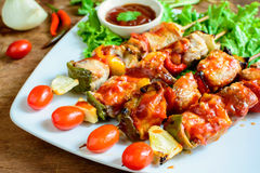 Grilled pork barbecue with sauce. On wooden table royalty free stock images