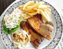 Grilled pork belly with fries and salad Royalty Free Stock Image