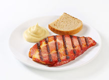 Grilled pork with bread and mustard Royalty Free Stock Image