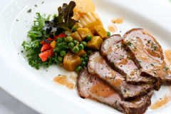 Grilled pork. With brown sauce served with vegetable Royalty Free Stock Image