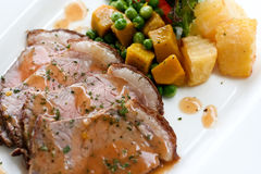Grilled pork. With brown sauce served with vegetable Royalty Free Stock Images