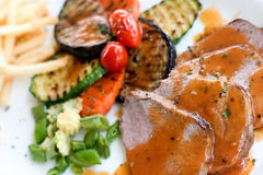 Grilled pork. With brown sauce and grilled vegetable Royalty Free Stock Image