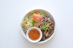 Grilled Pork Bun. Traditional Vietnamese rice vermicelli dish with shredded lettuce, bean sprout, scallion and ground peanut. Served with homemade sauce Stock Image