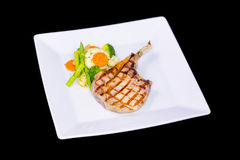 Grilled pork chop with asparagus Royalty Free Stock Photo