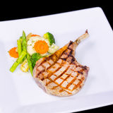 Grilled pork chop with asparagus Stock Photo
