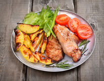 Grilled pork chop with baked potatoes Royalty Free Stock Photos