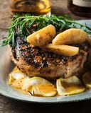 Grilled pork chop with bourbon spiced maple apples served with r Stock Photos