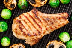 Grilled pork chop with brussels sprouts Stock Photography