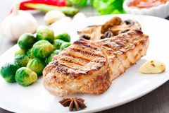 Grilled pork chop with brussels sprouts Royalty Free Stock Photo
