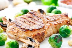 Grilled pork chop with brussels sprouts Royalty Free Stock Photography
