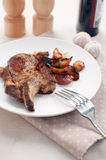 Grilled pork chop and caramelized onions Stock Images