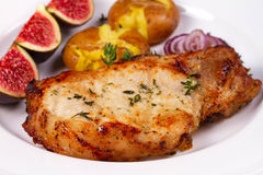 Grilled Pork Chop with Figs on Scewer, Crisp Roasted Potatoes and Thyme. Royalty Free Stock Photos