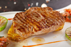 Grilled Pork Chop. Grilled Foods - BBQ Pork Chop on Potato with Vegetables Stock Photos