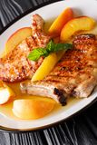 Grilled pork chop with glazed peaches and honey garlic sauce clo stock photography
