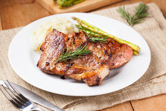 Grilled pork chop with mashed potato and asparagus Stock Images