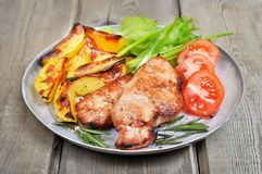 Grilled Pork Chop On Rustic Table Royalty Free Stock Photo