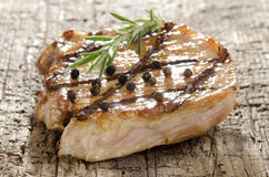 Grilled pork chop with peppercorns Stock Photos