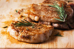 Grilled pork chop with rosemary leaf Royalty Free Stock Photo