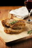 Grilled pork chop with rosemary Stock Photography