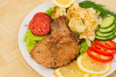 Grilled pork chop with a side dish of cauliflower and vegetables Stock Photos